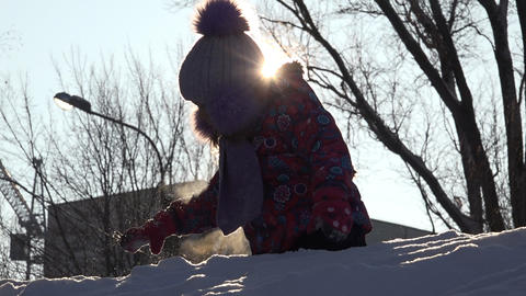 Cute Child Playing in Snow in Winter. Sunny day Footage