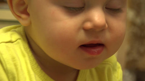 Cute Baby Eating an Apple, First Teeth. First Try to Chewing. 4K UltraHD, UHD Footage