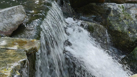 Water flows down from the waterfall Footage