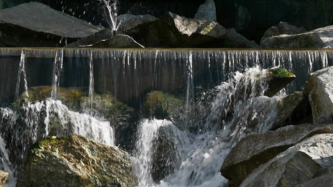 Water on a wild waterfall flows down the rocks Footage