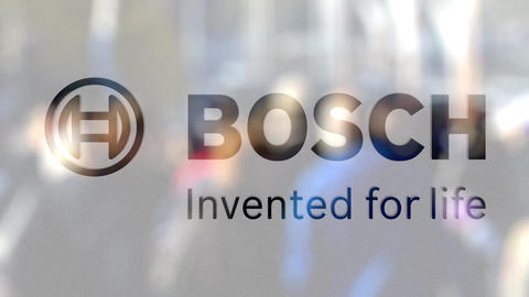 Robert Bosch GmbH logo on a glass against blurred crowd on the steet. Editorial Live Action