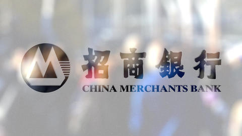 China Merchants Bank logo on a glass against blurred crowd on the steet Footage