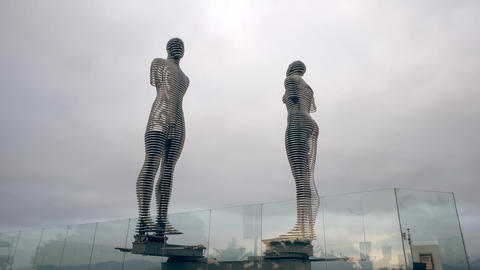 Moving Metal Sculpture of a Man and Woman Footage