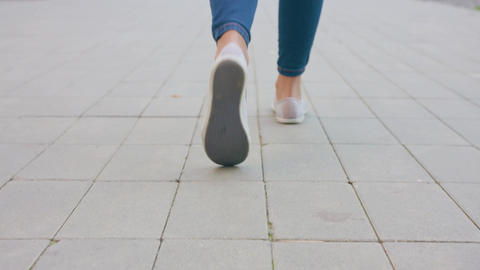 Young Lady's Feet Walking on the Cobblestone Footage