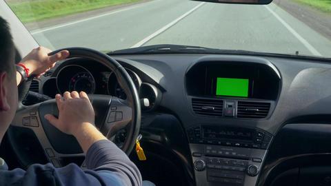 Inside a Car. A GPS Module is On. Green Screen Footage