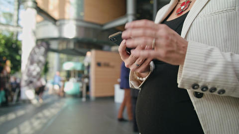 A Young Pregnant Lady Using a Smartphone Image