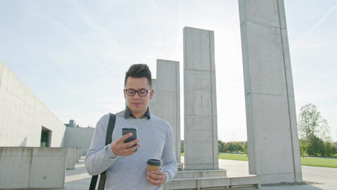 A Young Man Using a Phone Outside Archivo