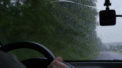 Man drives a car in rainy weather Footage