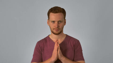ginger male shows sign namaste Live Action