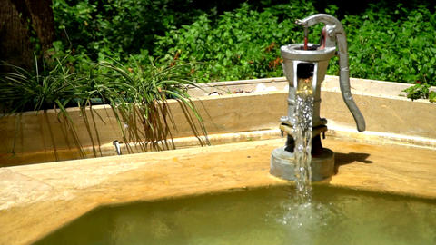a water pump mounted in the form of a fountain Footage