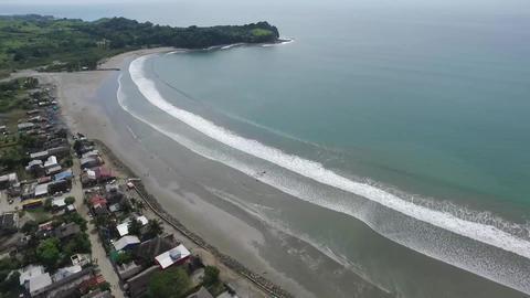 Aerial - Surfer Town in Tropical Beach II Filmmaterial
