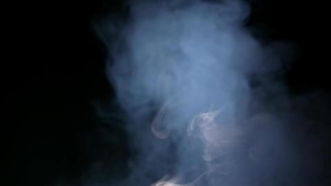 White Smoke Isolated on Black Background Image