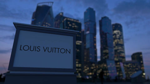 Street signage board with Louis Vuitton logo in the evening. Blurred busines Footage