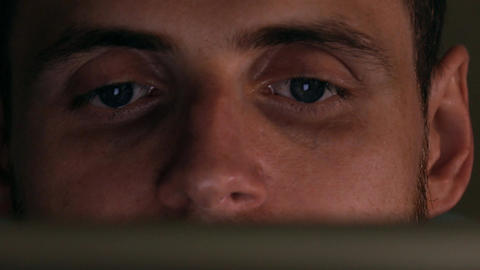 Gray eyes of focused intelligent young man using his tablet computer. Screen Live Action