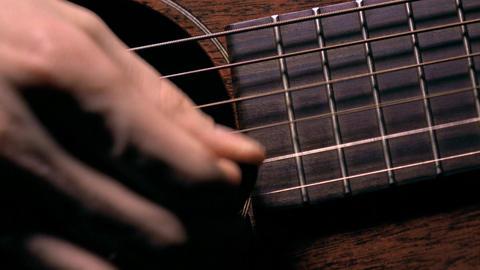 Man strumming the guitar. Music performance. 4K macro video Footage