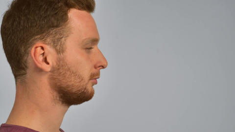 half-face ginger male sneezes Footage