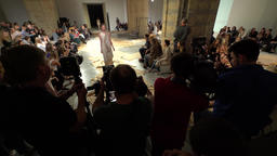 Cameramen and photographers shoot fashion show on the catwalk Footage