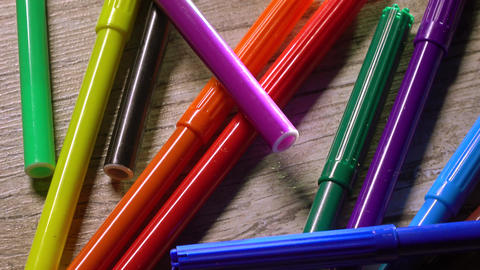 Multicolor felt pens on wooden table. Warm colors. 4K closeup pan video Image