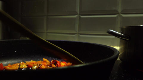 Frying cut sweet pepper pieces 4K video Live Action