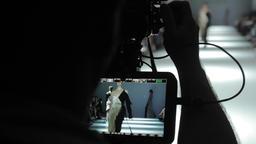 TV. Camera cameraman shoots fashion show Footage