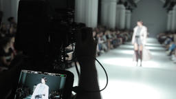 TV camera on fashion show. Cameraman at work on the catwalk Footage