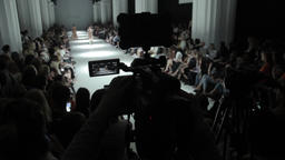 Press zone on fashion show. Photographers and cameramen at work Footage