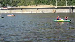 people on board and paddling - canoeing - boats on the river (Vltava) - city (bu Footage