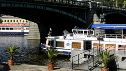 boats on the river in quay (Vltava) - bridge - cars and trees - people walking - Footage