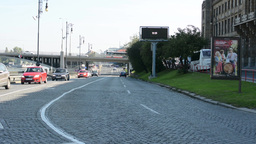 city - urban street with cars - bridge - lamps - buildings - grass and tre Footage