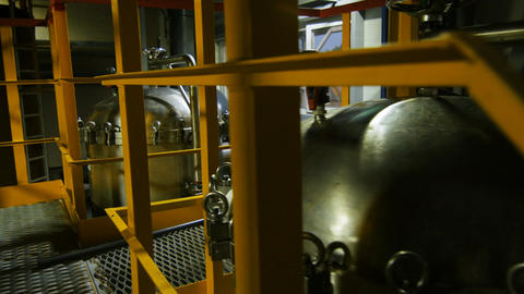 View Through Yellow Handrail on Large Spherical Tanks Footage