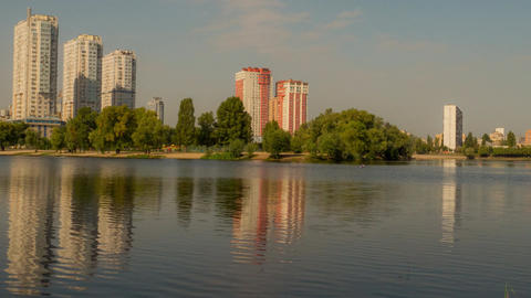 Autumn lake in the background city Image