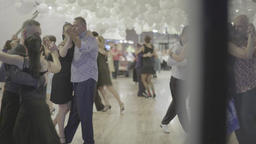 Many couples are dancing tango (milonga). Dancers on the dance floor Footage