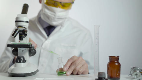 Doctor studying chemical element in laboratory using a microscope Footage