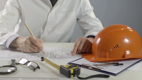 Architect or engineer working on blueprint. Architects workplace - architectural Footage