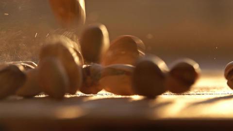 Slow motion shot of falling pistachios Footage