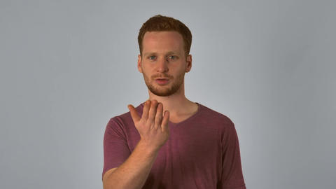 ginger male shows sign kissing Image