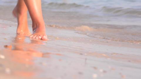 Feet, walking barefoot on wet sandy beaches Footage
