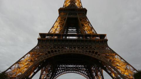 PARIS, FRANCE - OCTOBER 7, 2017. Lit Eiffel tower in the evening, tilt shot Footage