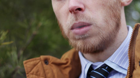 the guy lights a cigarette. a harmful habit, a threat to... Stock Video Footage