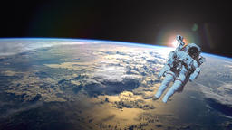 Astronaut in outer space against the backdrop of the planet earth. Elements of Image