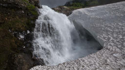 Bottom view of high waterfall falling in snowfield Footage