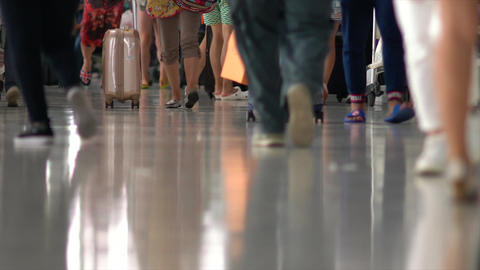 Travelers Are Walking With Luggage In Airports Footage