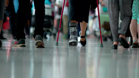 Senior women wearing ankle support with walking crutches Footage