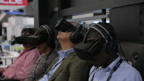 Adult mans using Gear Virtual Reality headsets Stock Video Footage