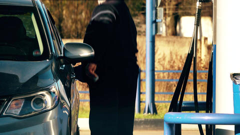 Unrecognizable man refueling his car at the gas station Footage