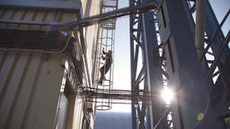 Worker climbs up on the silo Footage