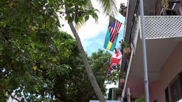 Bahamas Nassau colonial style balcony with flag of the USA Footage