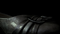 Silver shoe isolated against a black background HD stock footage Footage