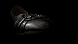 Silver Shoe Isolated Against A Black Background HD Stock Footage stock footage
