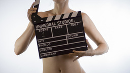 Nude girl with Clapper Board Footage